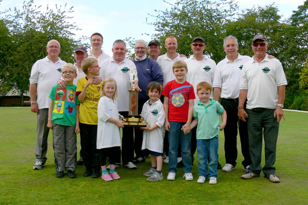 Crown Green Bowls Team Image with family after winning a final.